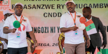 FILE - In this Jan. 26, 2020, file photo, Burundi Army Gen. Evariste Ndayishimiye, left, is accompanied by president Pierre Nkurunziza, right, after Ndayishimiye was chosen as the party's presidential candidate at a national conference for the ruling CNDD-FDD party in the rural province of Gitega, Burundi. Burundi's government said Tuesday, June 9, 2020 that President Pierre Nkurunziza has died of a heart attack. (AP Photo/Berthier Mugiraneza, File)
