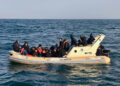 """hand out image made available by the Societe Nationale de Sauvetage en Mer (SNSM) on February 18, 2019, shows British rescuers helping some 20 migrants on a semi-rigid boat trying make their way from France across the English Channel. - Twenty migrants who tried to reach England aboard a motorboat were intercepted in the Channel by the British authorities in the English zone, said the maritime prefecture on February 18, 2019. """"A fishing vessel gave the alert a little after 8am"""", after spotting this group of """"18 to 20 migrants"""" off Cape Gris-Nez, said the same source. (Photo by Handout / SOCIETE NATIONAL DE SAUVETAGE EN MER / AFP) / RESTRICTED TO EDITORIAL USE - MANDATORY CREDIT """"AFP PHOTO / SNSM"""" - NO MARKETING NO ADVERTISING CAMPAIGNS - DISTRIBUTED AS A SERVICE TO CLIENTS"""