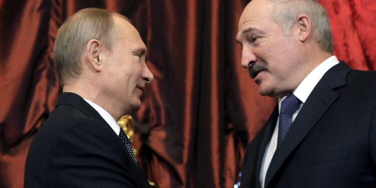 Russian President Vladimir Putin (L) welcomes Belarussian President Alexander Lukashenko (R) during their meeting at the Kremlin in Moscow, on December 23, 2014.  Presidents of Armenia, Belarus, Kazakhstan, Kyrgyzstan and Tajikistan arrived in Moscow to take part in the  CSTO (Collective Security Treaty Organisation) Collective Security Council meeting to discuss strengthening allied cooperation among the CSTO member countries and current regional affairs. AFP PHOTO/MAXIM SHIPENKOV (Photo by MAXIM SHIPENKOV / POOL / AFP)