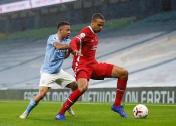 Liverpool's German-born Cameroonian defender Joel Matip (R) holds off Manchester City's Brazilian striker Gabriel Jesus (L) during the English Premier League football match between Manchester City and Liverpool at the Etihad Stadium in Manchester, north west England, on November 8, 2020. (Photo by Clive Brunskill / POOL / AFP) / RESTRICTED TO EDITORIAL USE. No use with unauthorized audio, video, data, fixture lists, club/league logos or 'live' services. Online in-match use limited to 120 images. An additional 40 images may be used in extra time. No video emulation. Social media in-match use limited to 120 images. An additional 40 images may be used in extra time. No use in betting publications, games or single club/league/player publications. /  (Photo by CLIVE BRUNSKILL/POOL/AFP via Getty Images)